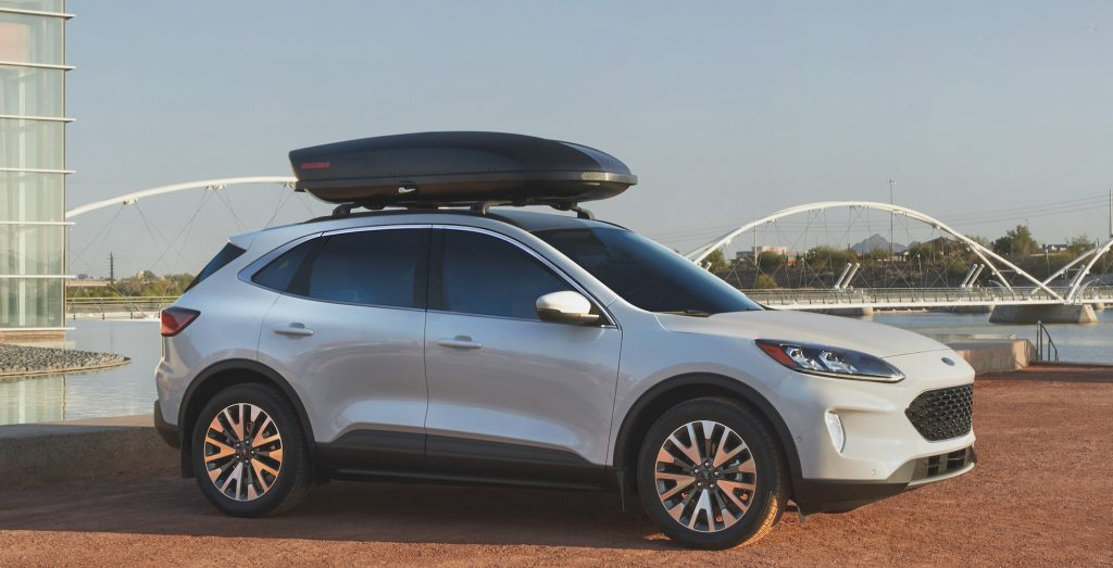A white 2021 Ford Escape compact SUV parked overlooking a lake