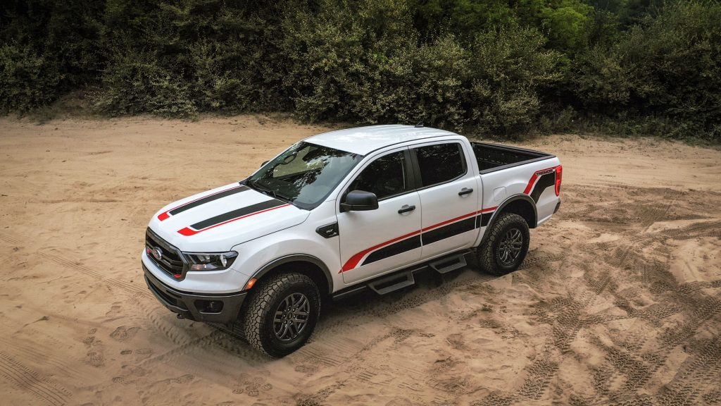 A white-with-red-and-black-stripes 2021 Ford Ranger XLT Tremor on a dusty trail
