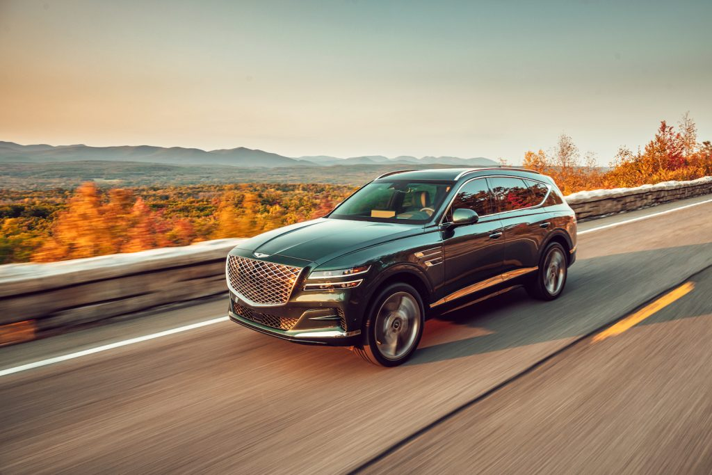 A black 2021 Genesis GV80 driving in the Hudson Valley, the 2021 Genesis GV80 is the best luxury SUV of 2021 according to KBB