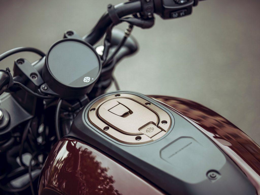 A close-up look at a maroon-and-black 2021 Harley-Davidson Sportster S's TFT dash and handlebars
