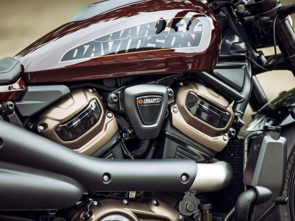 A close-up look at a maroon-and-black 2021 Harley-Davidson Sportster S's engine