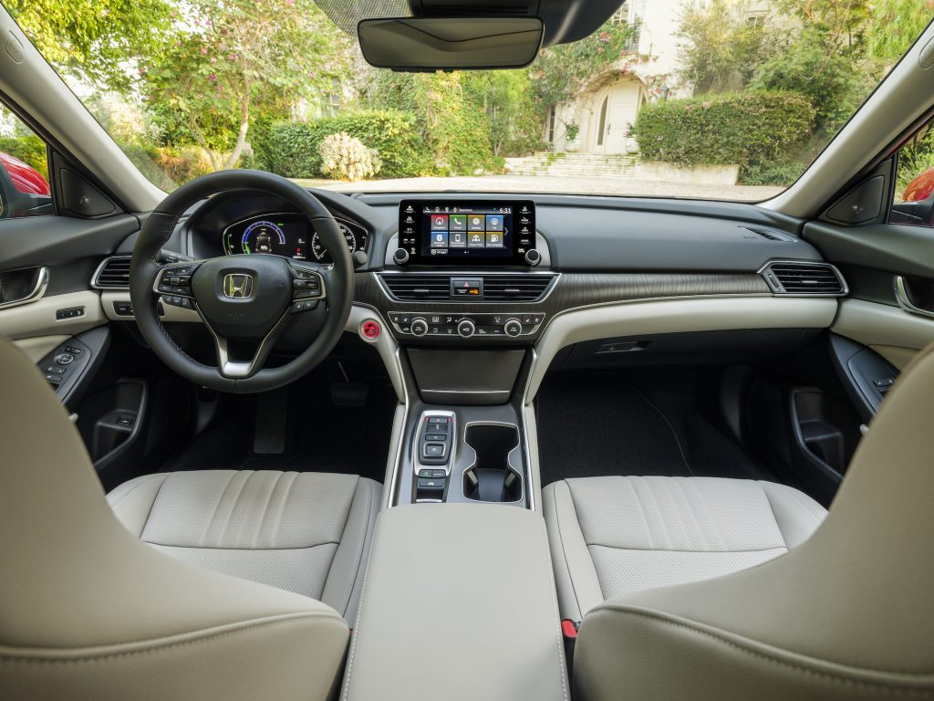 The dashboard, steering wheel and front seats of a 2021 Honda Accord Hybrid