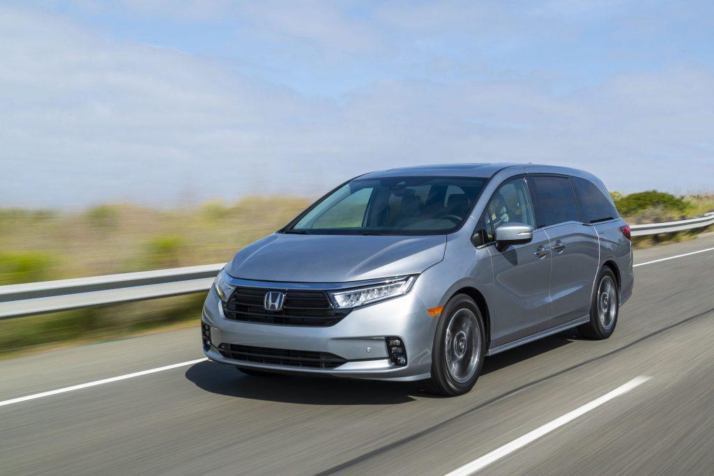 Honda minivan cruising down the highway