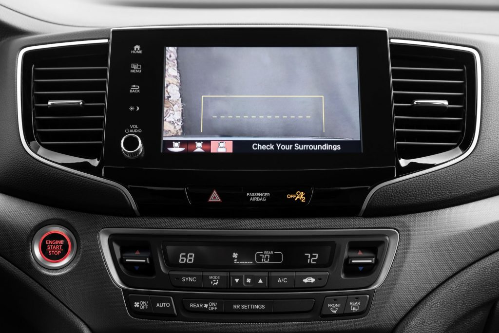 The infotainment screen of a 2021 Honda Ridgeline pickup truck displaying the backup camera function