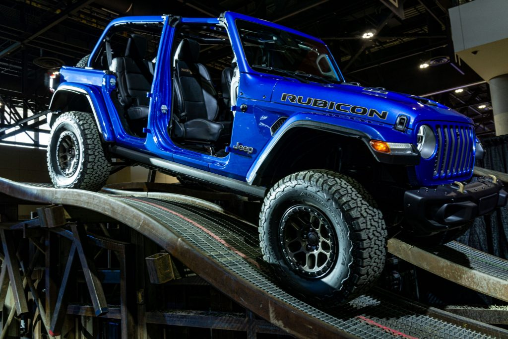 A blue 2021 Jeep Wrangler Rubicon 392 Xtreme Recon parked on a ramp heading down