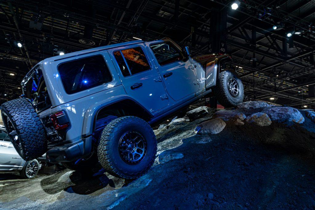 A gray 2021 Jeep Wrangler Rubicon Xtreme Recon climbs a simulated rocky hill