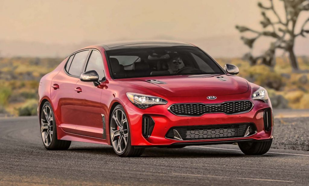 A red 2021 Kia Stinger driving