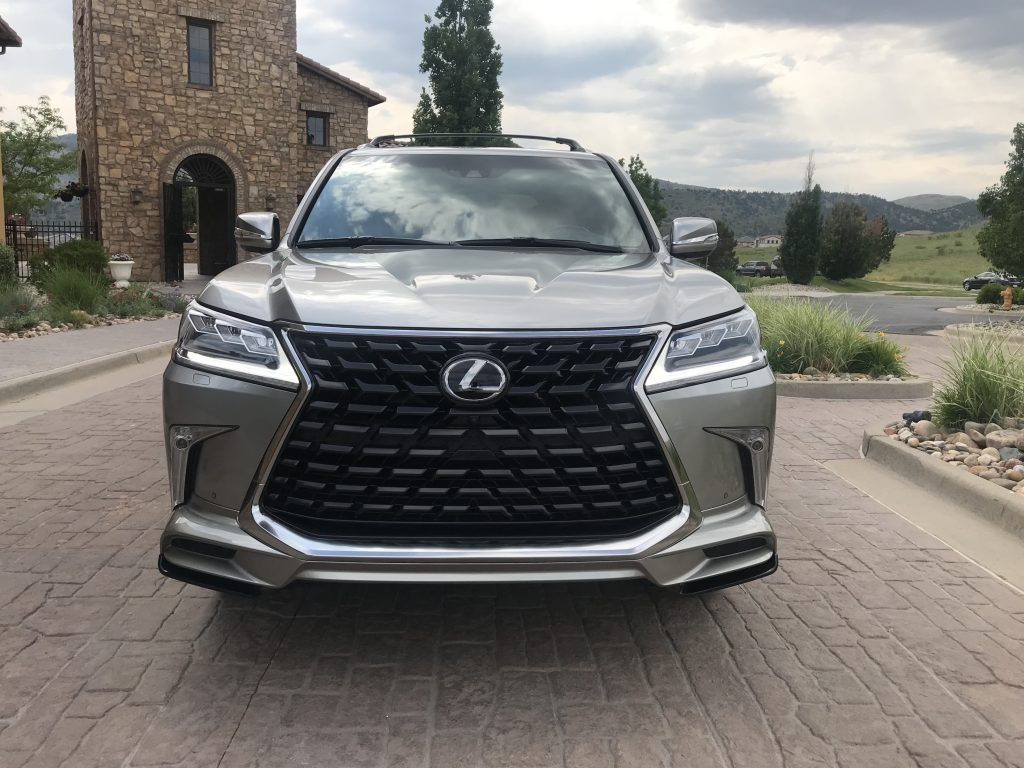 Front shot of the 2021 Lexus LX 570 as it sits in a parking lot driveway for our full review.