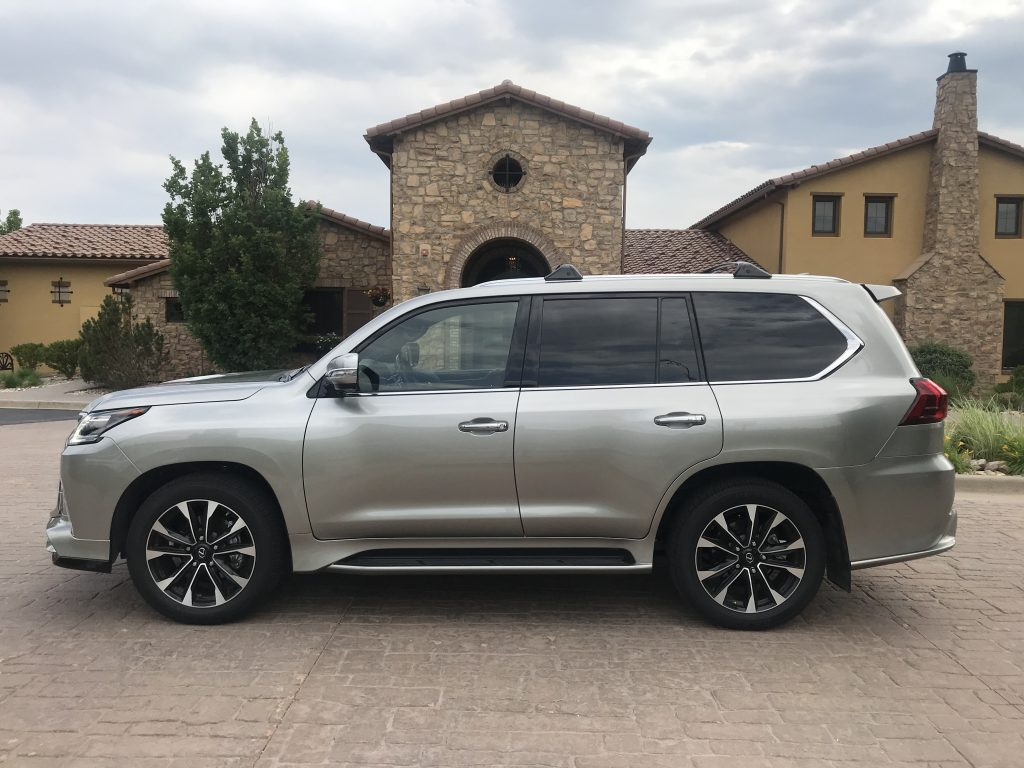 Side shot of the 2021 Lexus LX 570 as it sits in a parking lot driveway for our full review.