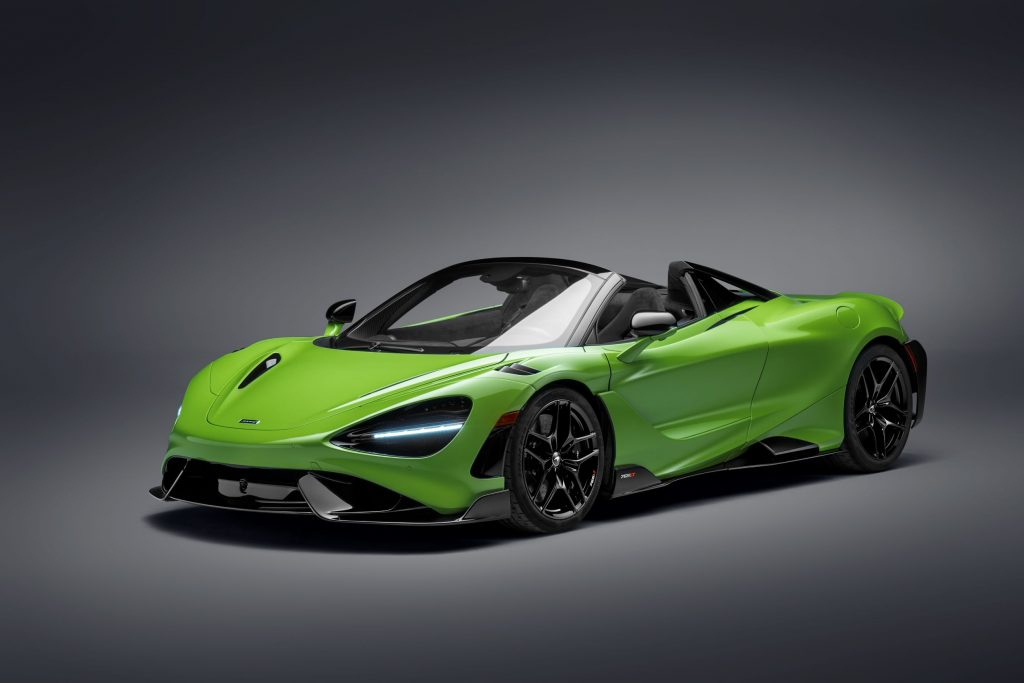 A green-and-black 2021 McLaren 765LT Spider with its roof down