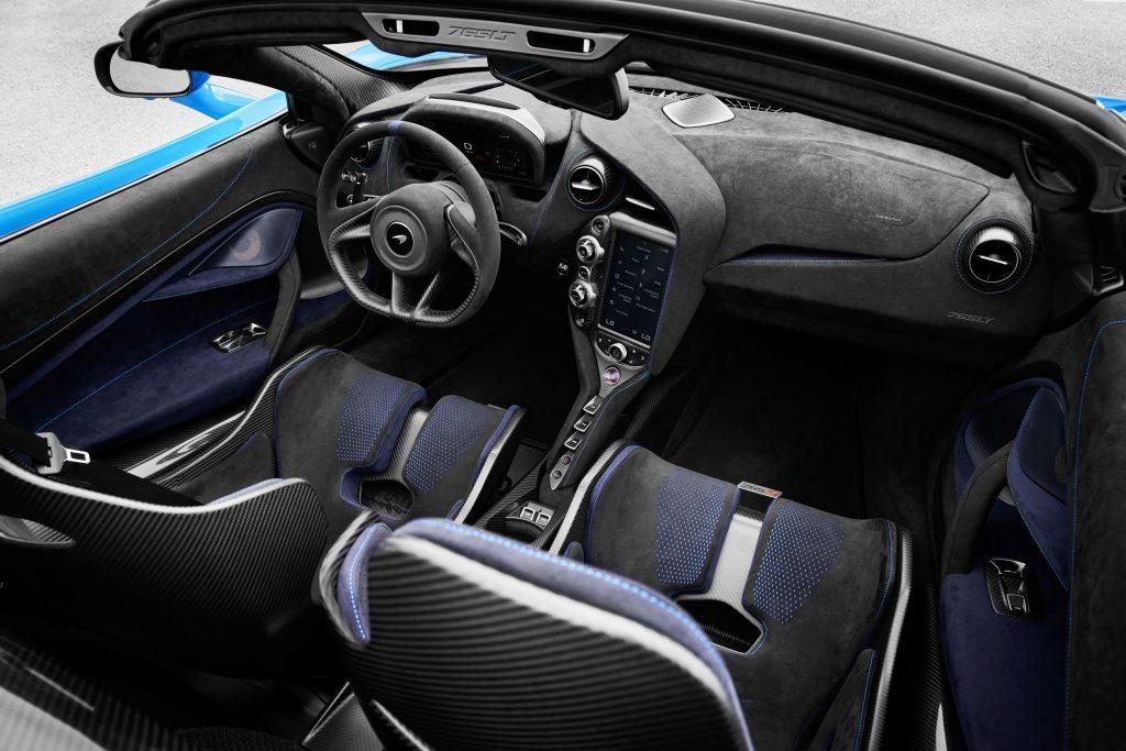 The black-and-blue Alcantara-and-carbon-fiber interior of a blue 2021 McLaren 765LT Spider