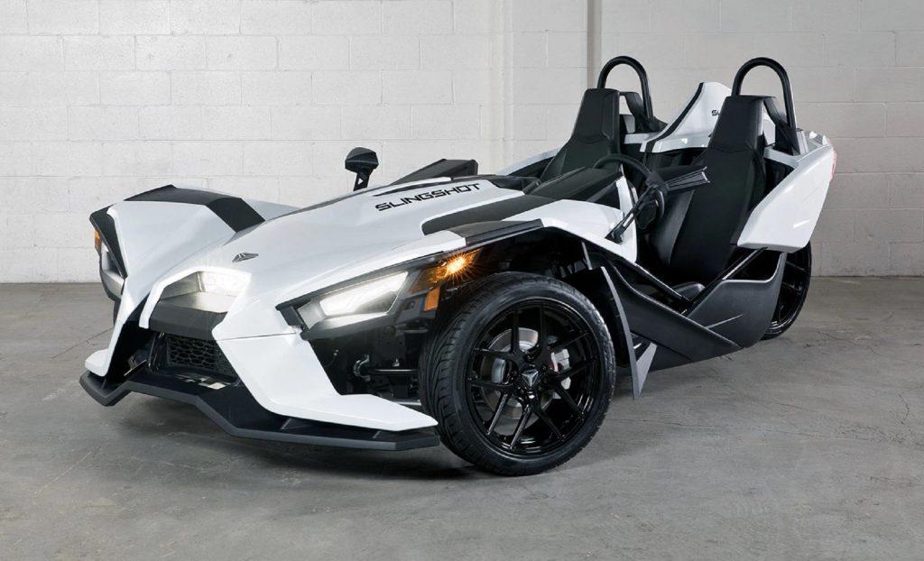 A white 2021 Polaris Slingshot S in a parking garage