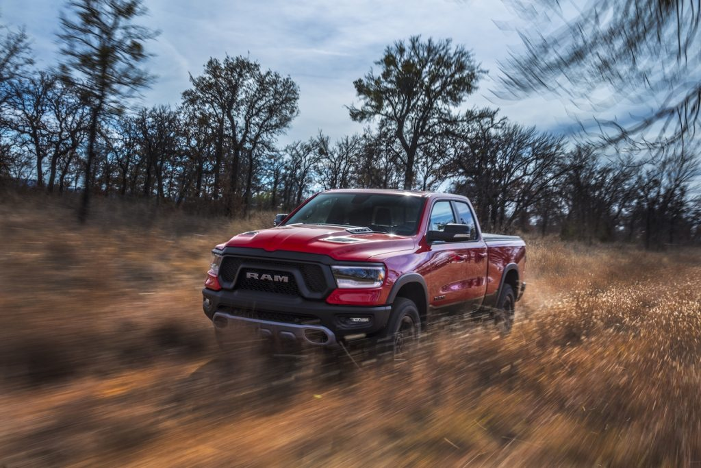 A red 2021 Ram 1500 driving through the dirt, the 2021 Ram 1500 is one of the best 4WD trucks of 2021