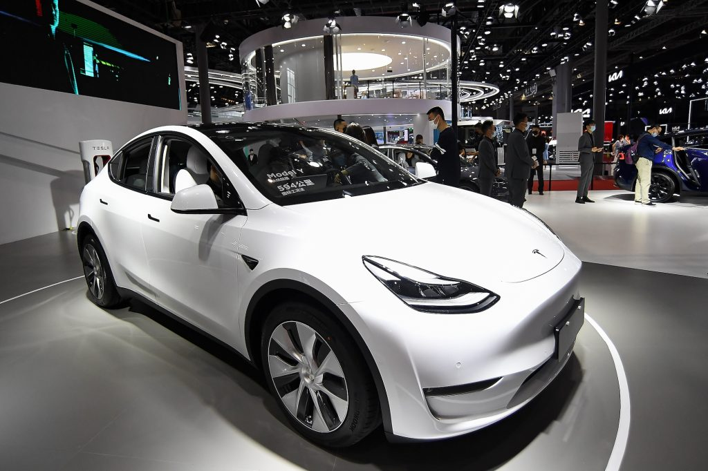 A white 2021 Tesla Model Y electric crossover SUV on display at Auto Shanghai 2021