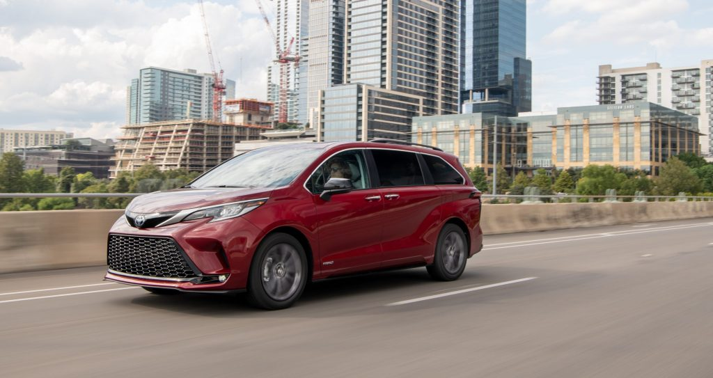 Red 2021 Toyota Sienna Driving Down The Highway