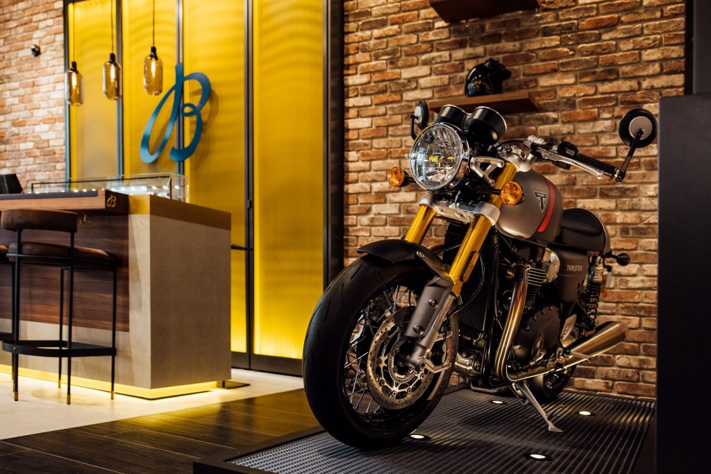 A black-silver-and-red 2021 Triumph Thruxton RS on display at the Breitling Boutique in Hamburg