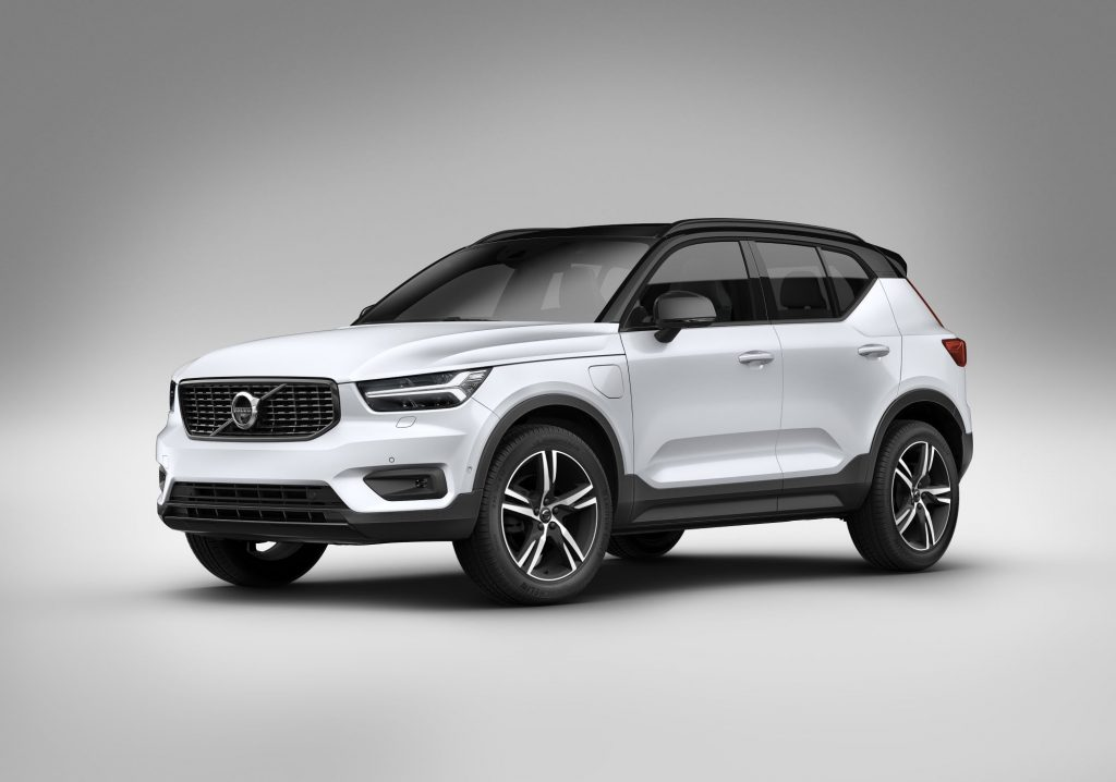 A white 2021 Volvo XC40 in front of a cream background and ground with a black vignette on the outside edges.