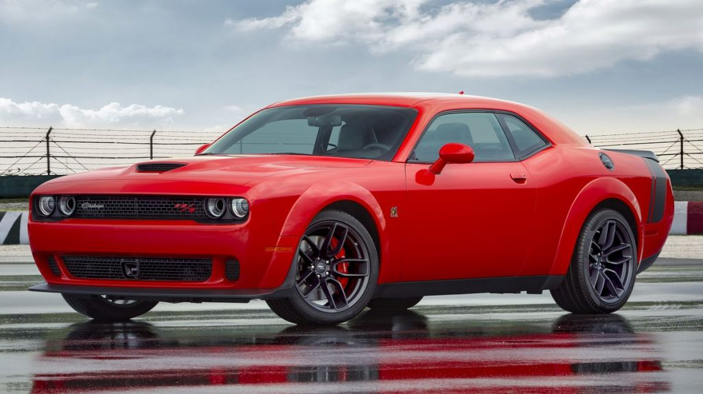 A red 2021 Dodge Challenger parked on the track