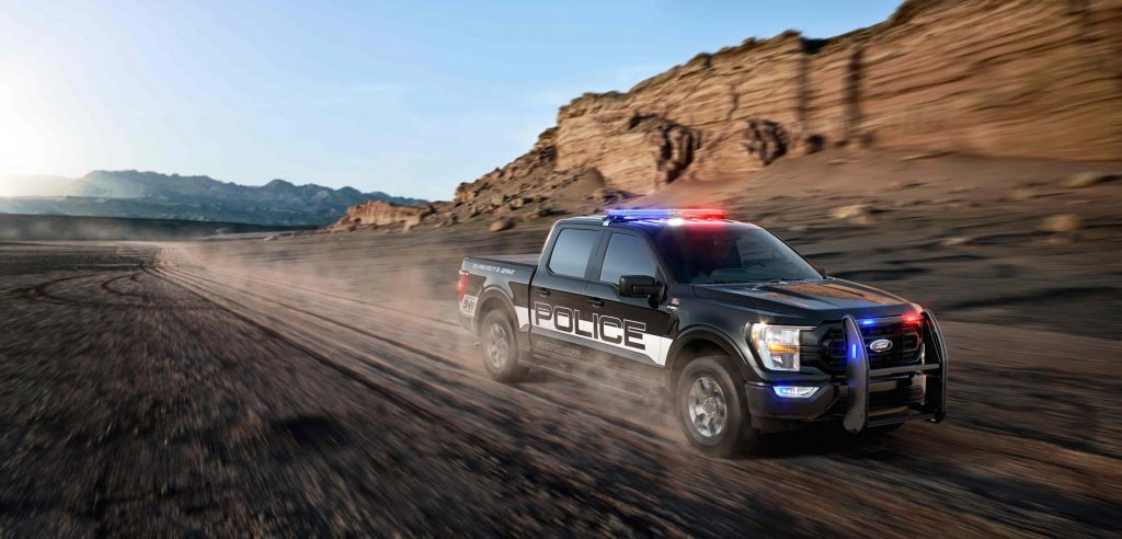 The 2021 Ford F-150 Police Responder racing down a dirt road