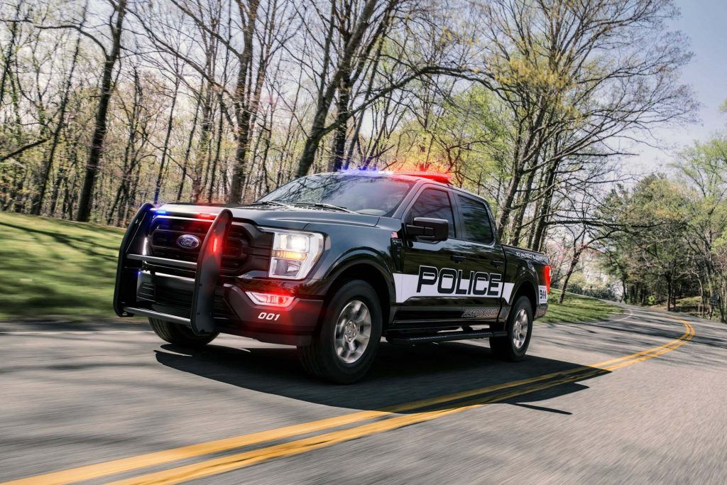The 2021 Ford F-150 Police Responder racing down the road with its lights on