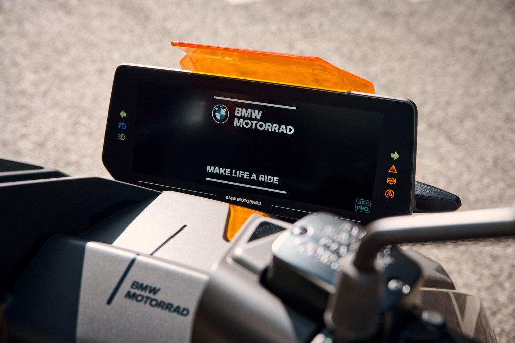 The TFT dash of a gray-and-orange 2022 BMW CE 04