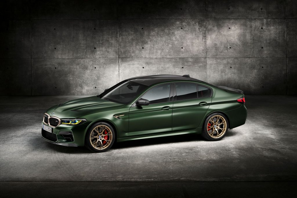 The side 3/4 view of a green 2022 BMW M5 CS