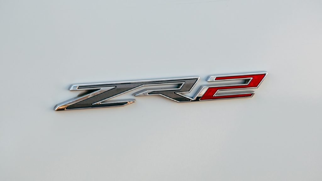 A close-up of the badge on a white 2022 Chevrolet Silverado ZR2