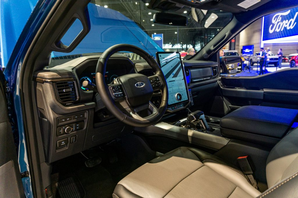 The driver's side front interior of a 2022 Ford F-150 Lightning at the 2021 Chicago Auto Show