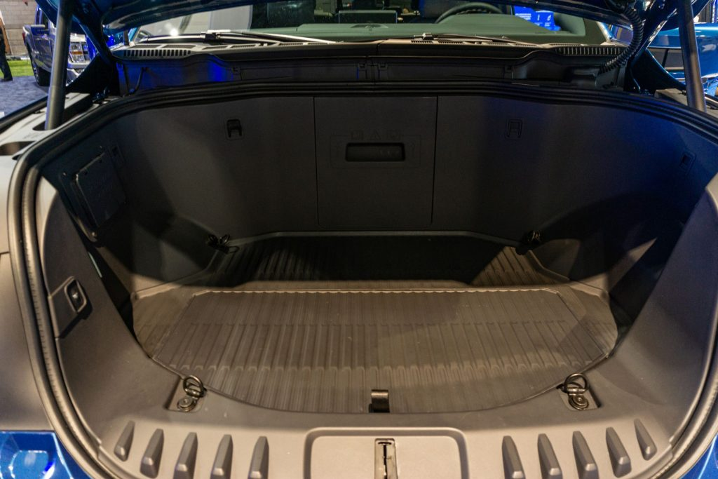 The open frunk of a blue 2022 Ford F-150 Lightning at the 2021 Chicago Auto Show