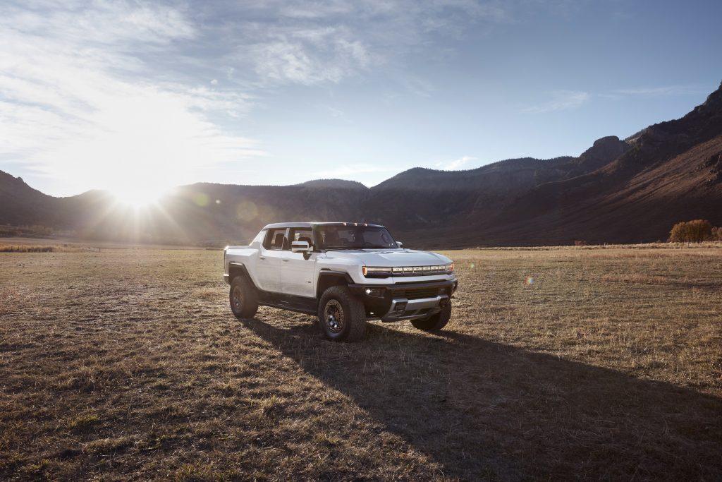 Hummer EV parked in the desert at sunset