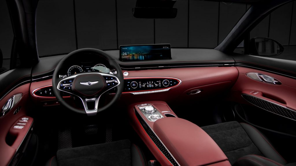 The red-and-black-leather front seats and dashboard of a 2022 Genesis GV70 3.5T Sport