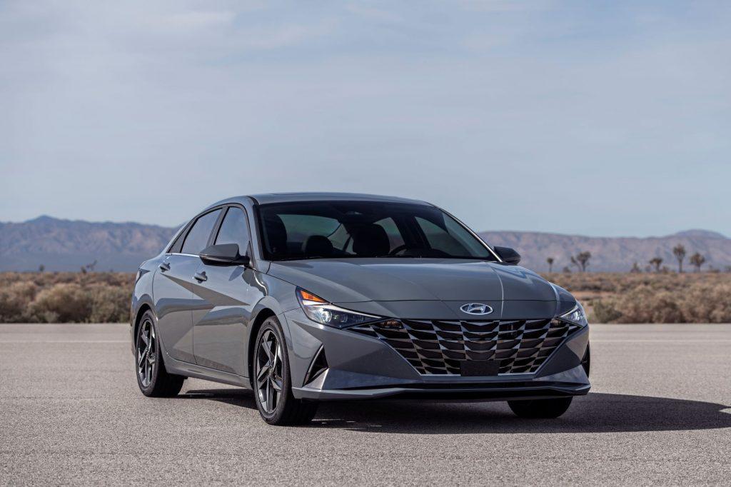 A grey 2022 Hyundai Elantra Hybrid in a desert area.
