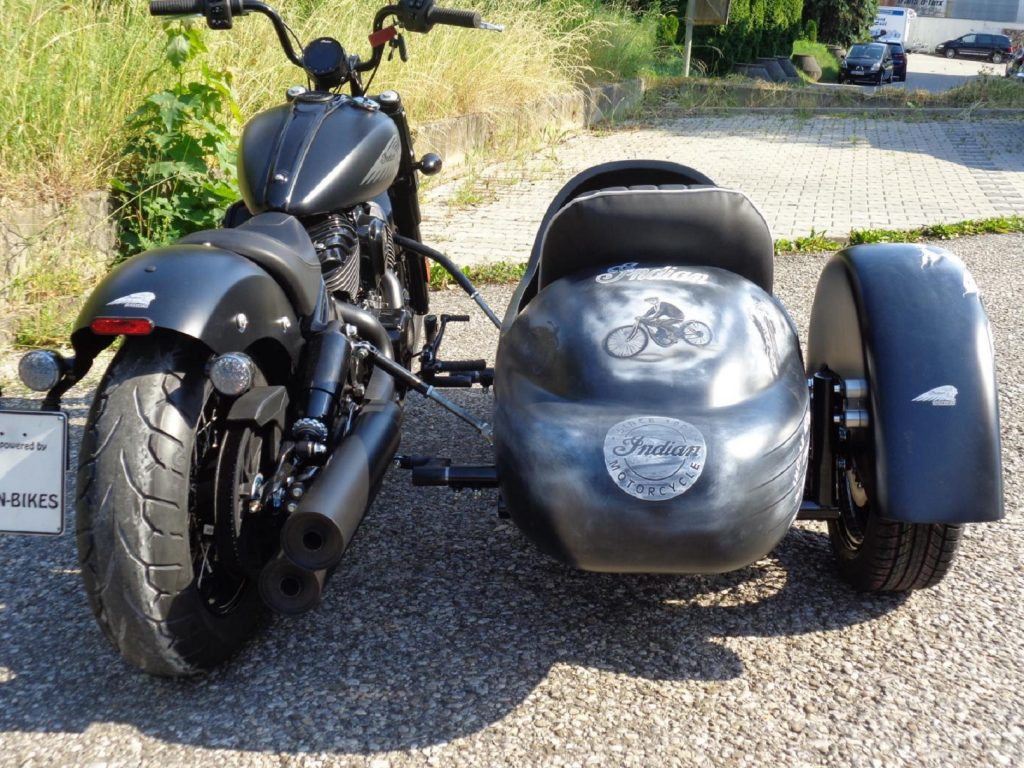 The rear view of a black 2022 Indian Chief Bobber with Iwan Bikes' BellaVista sidecar