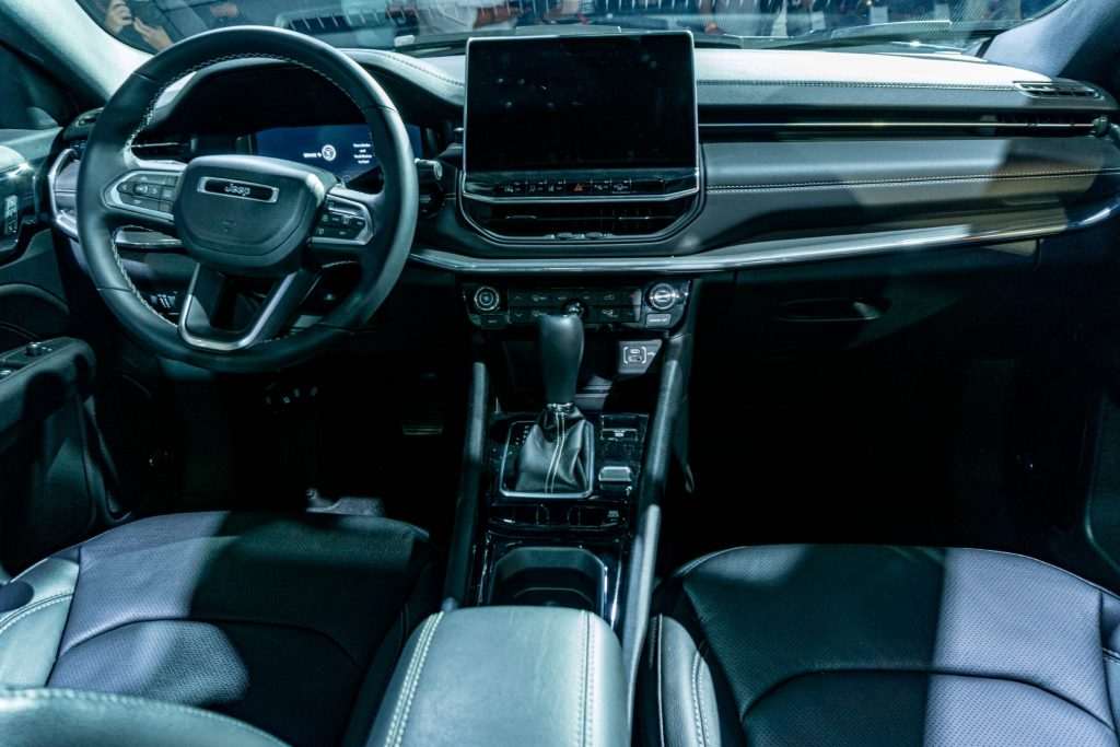 The black-leather-upholstered front seats and dashboard of the 2022 Jeep Compass Latitude LUX