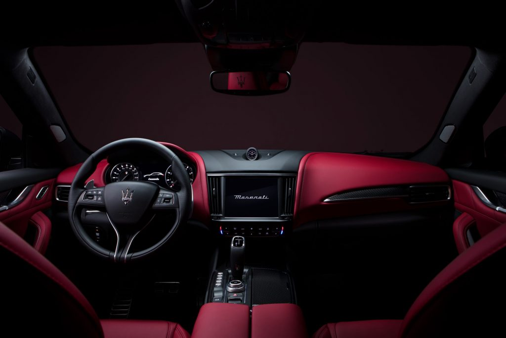 The red-and-black leather front seats and dashboard of the 2022 Maserati Levante Modena SUV
