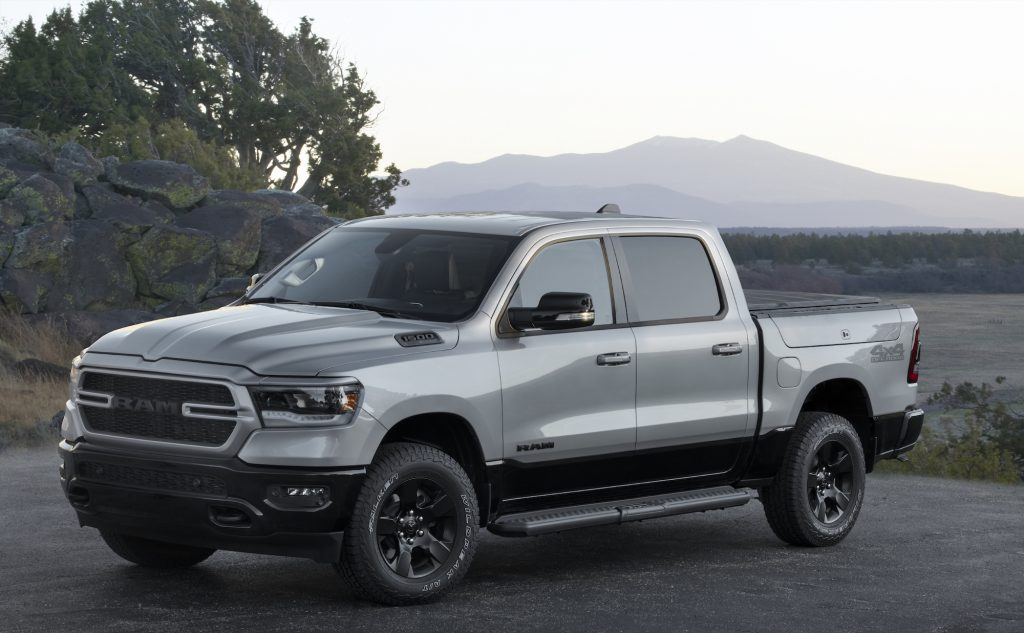 A 2022 Ram 1500 BackCountry pickup truck parked on asphalt in front of a plain and mountains