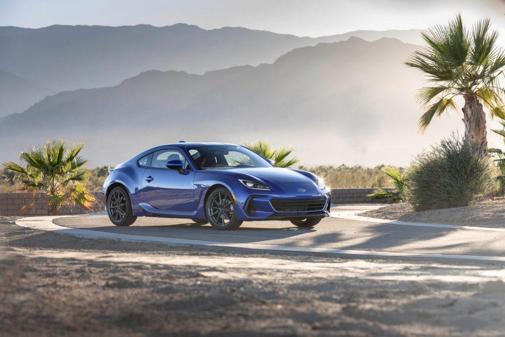 A blue 2022 Subaru BRZ on a desert racetrack