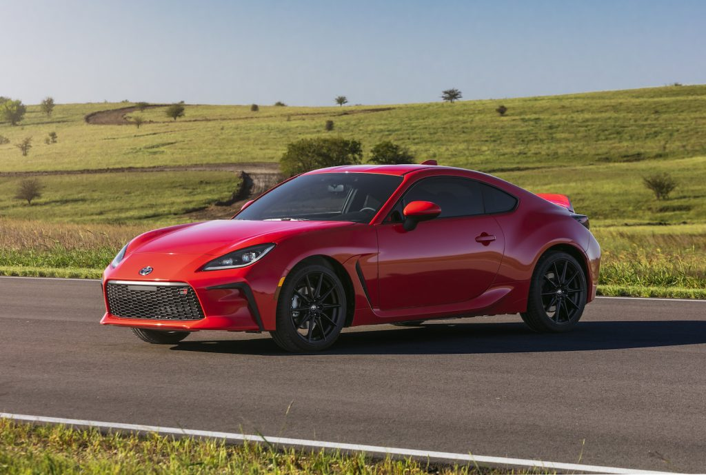 A red 2022 Toyota GR 86 parked near a grassy field, the 2022 Toyota GR 86 is a reliable sports car under $40,000