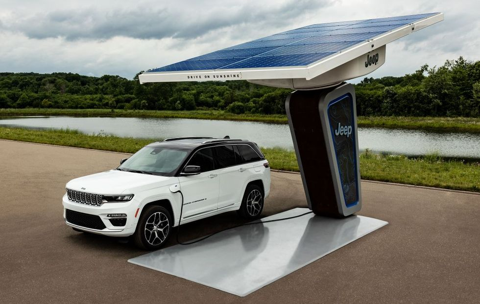 The 2022 Jeep Grand Cherokee 4xe charging at a trailhead