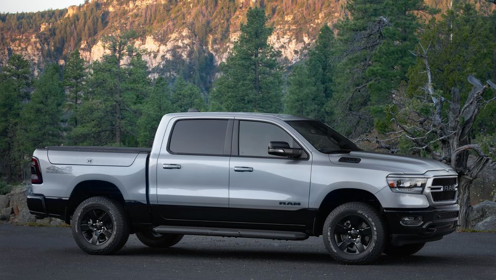 The 2022 Ram 1500 BackCountry Edition from the side and in front of trees