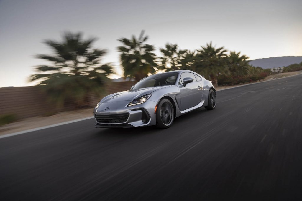 A silver 2022 Subaru BRZ driving, the BRZ is an affordable sports car under $40,000