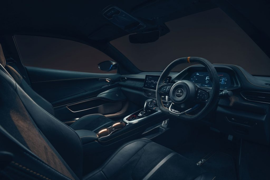 The black seats and dashboard of a UK-market 2023 Lotus Emira