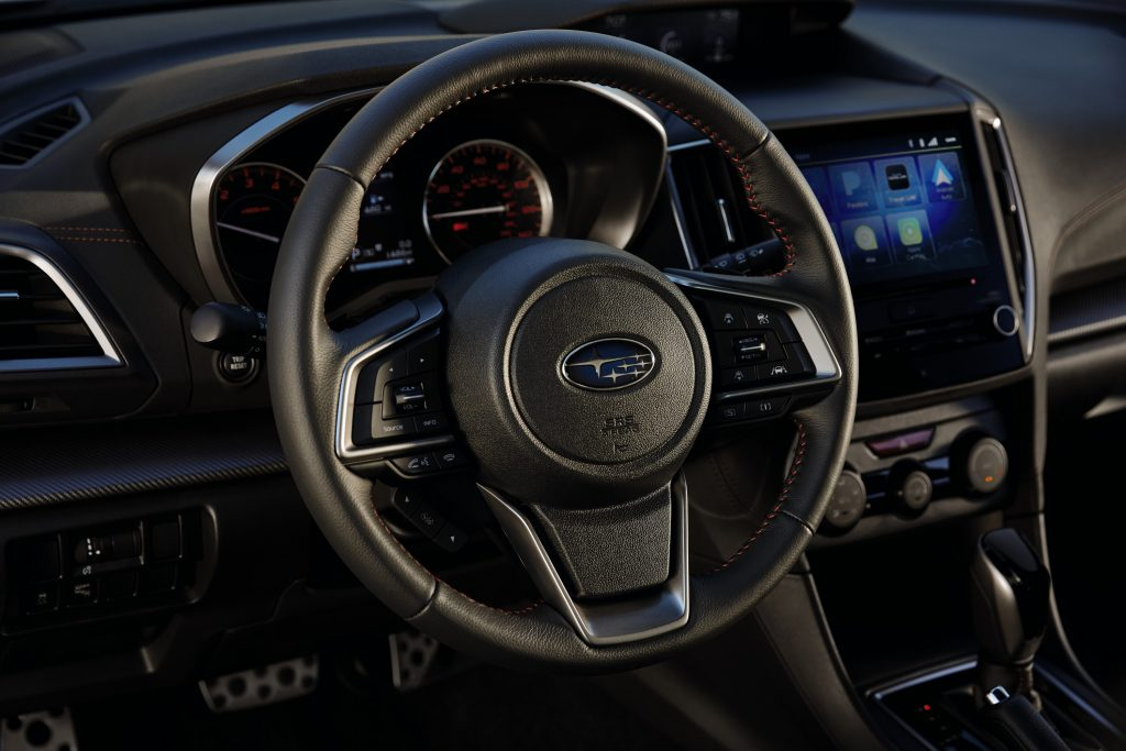 The Impreza's leather-wrapped steering wheel