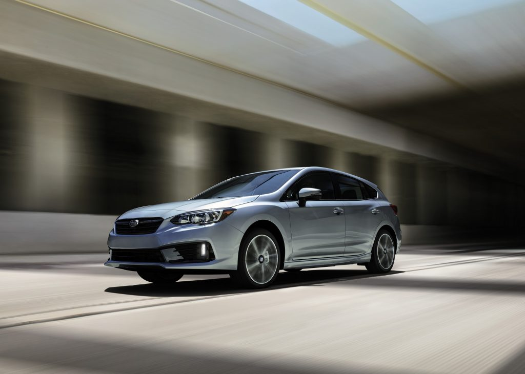 The Subaru Impreza in silver, photographed driving through an underpass