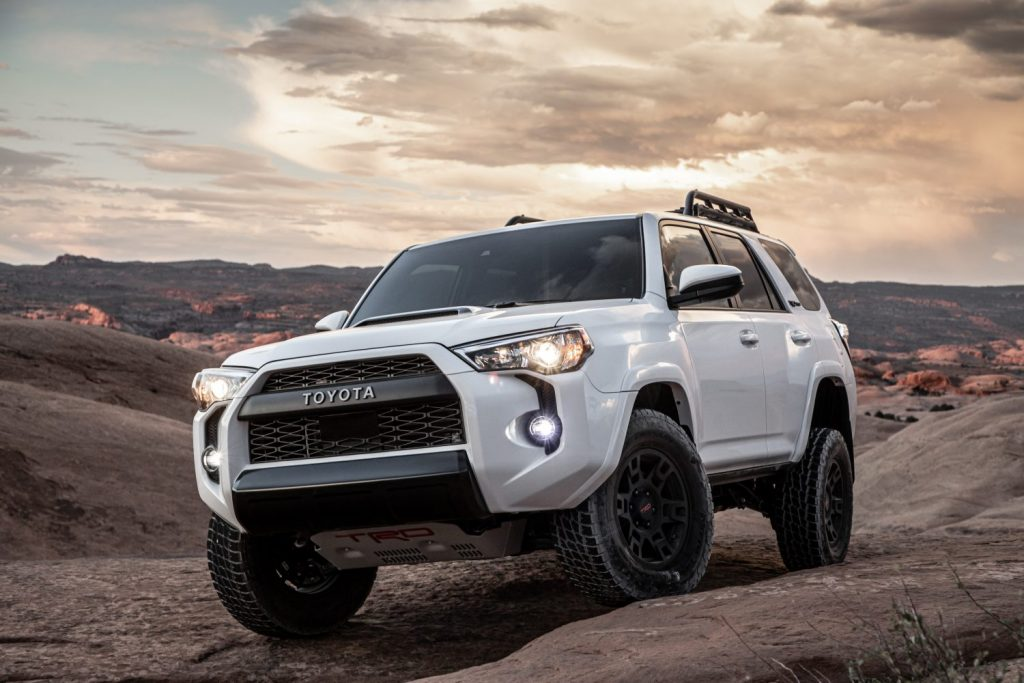 A white 2020 Toyota 4Runner TRD pro climbing rocks on mountain trails