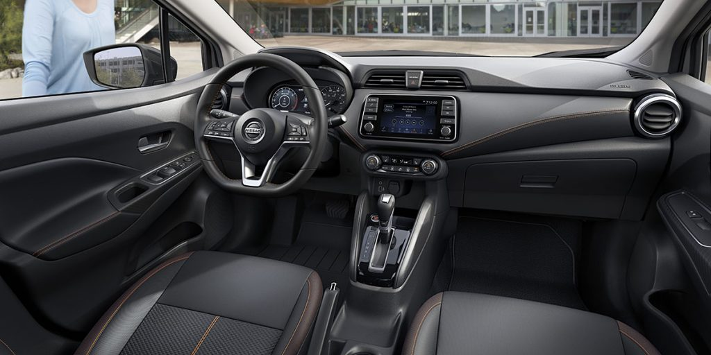 the interior view of the 2021 Nissan Versa compact car with sport cloth trim.