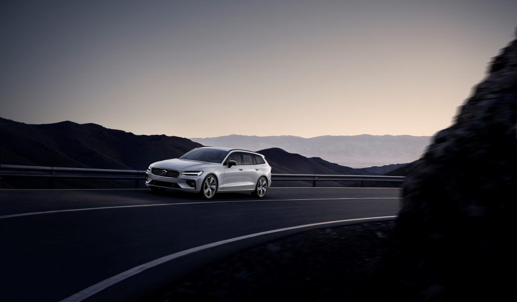 Silver Volvo V60 driving up a mountain road