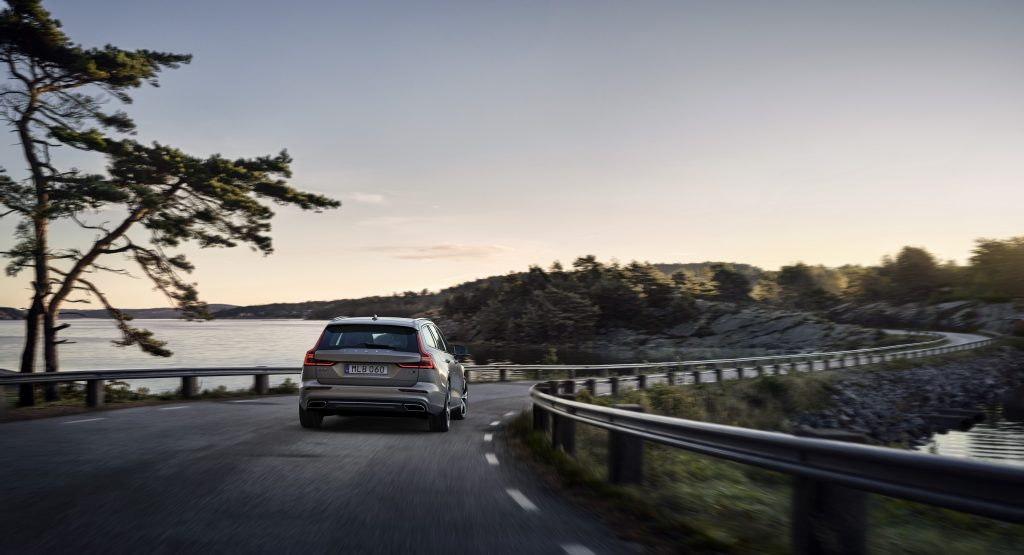 A grey Volvo V60 driving down a winding road