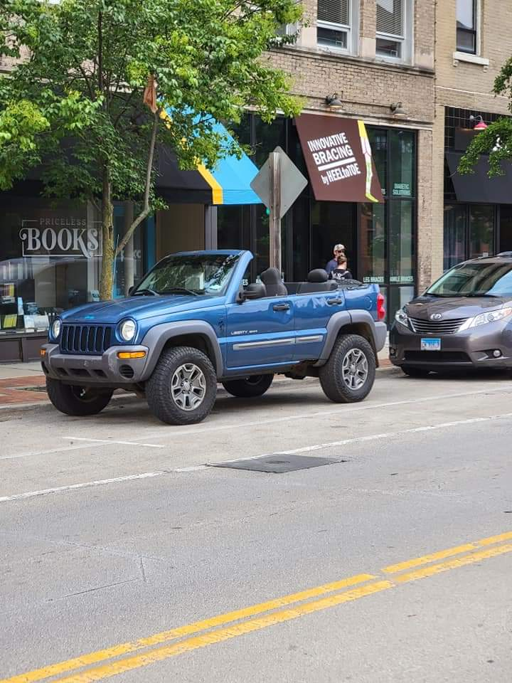 The blue convertible Jeep Liberty, made by Reddit user u/Total_Offroad_Steve