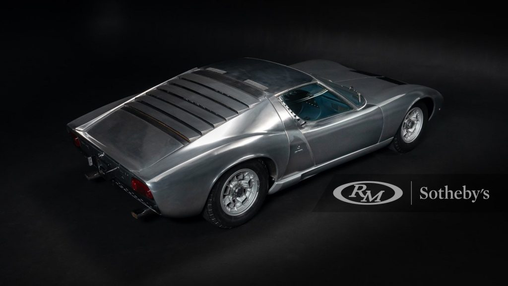 The rear of the bare metal Miura, shot in a black photobooth